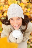 Autumn woman drinking coffee in fall forest Royalty Free Stock Photos