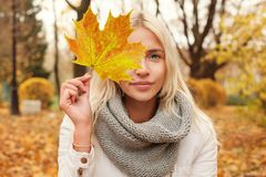 Autumn woman with fall leaf walking. Outdoors royalty free stock image