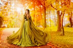 Autumn Woman, Fashion Model Outdoor Portrait, Girl Fall Dress. Autumn Woman, Fashion Model Outdoor Portrait, Girl in Autumnal Dress walking in Yellow Fall Leaves Stock Photography