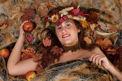 Autumn woman on fur Stock Photos