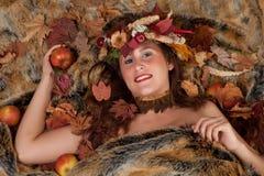 Autumn woman on fur Stock Photos
