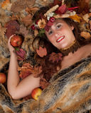 Autumn woman on fur blanket Royalty Free Stock Photos