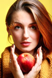 Autumn woman girl glamour eye-lashes red apple. Red apple woman in sepia fashion female, fresh girl glamour eye-lashes autumn colour Royalty Free Stock Images