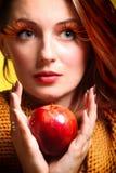 Autumn woman girl glamour eye-lashes red apple Stock Photos
