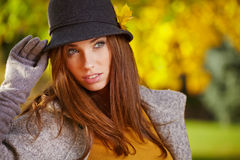 Autumn woman in golden park Stock Photo
