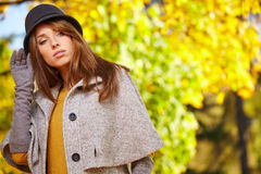 Autumn woman in golden park Stock Photos