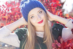Autumn woman happy with colorful fall leaves Royalty Free Stock Image