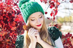 Autumn woman happy with colorful fall leaves Stock Photos