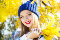 Autumn woman happy with colorful fall leaves Royalty Free Stock Photo