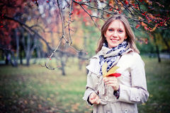 Autumn woman happy in fall park looking around having fun smiling in beautiful colorful forest foliage Stock Photos