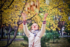 Autumn woman happy in fall park looking around having fun smiling in beautiful colorful forest foliage Royalty Free Stock Images