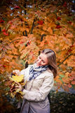 Autumn woman happy in fall park looking around having fun smiling in beautiful colorful forest foliage Royalty Free Stock Photo