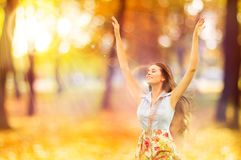 Autumn Woman, Happy Young Girl, Floating Model Open Arms in Yell Stock Photo