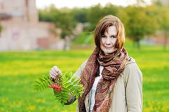 Autumn woman holding ashberry Stock Image