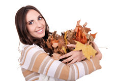 Autumn woman holding a pile of leaves Stock Image