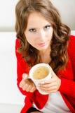 Autumn woman holds mug with coffee sitting on sofa Royalty Free Stock Photos