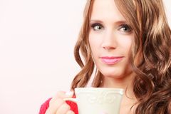 Autumn woman holds mug with coffee warm beverage. Attractive fall girl long hair holding white mug with coffee warm beverage. Woman warming herself Stock Image