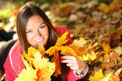 Autumn woman on leafs background Royalty Free Stock Images