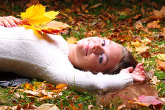Autumn woman on leafs background Stock Image
