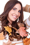 Autumn woman with leaves Royalty Free Stock Photography