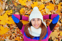 Autumn woman on leaves Stock Images