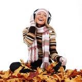 Autumn woman listening music Royalty Free Stock Image