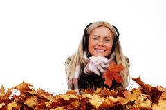 Autumn woman listening music Royalty Free Stock Images
