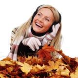 Autumn woman listening music Stock Photos