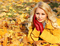 Autumn Woman with Maple leaves. Blonde Beautiful Girl Stock Image