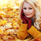 Autumn Woman with Maple leaves. Blonde Beautiful Girl in Fall Royalty Free Stock Photo