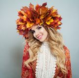 Autumn woman portrait. Smiling model in autumn leaves wreath.  royalty free stock images