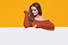 Autumn woman with publicity board Royalty Free Stock Images