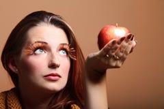 Autumn woman red apple fresh girl glamour eye-lashes Stock Image
