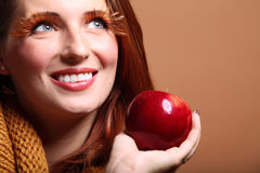 Autumn woman red apple fresh girl glamour eye-lashes Royalty Free Stock Photography