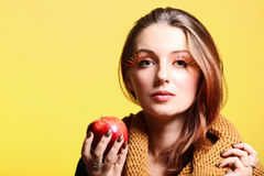 Autumn woman red apple fresh girl glamour eye-lashes Royalty Free Stock Image