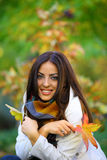Autumn woman sitting Royalty Free Stock Photography