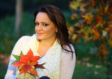 Autumn woman sitting Stock Photo