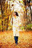 Autumn woman walking outdoors Stock Image