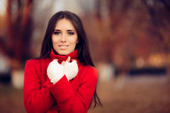 Autumn Woman Wearing Red Coat and Knitted Fingerless Gloves. Portrait of a cute girl feeling cold in fall time Royalty Free Stock Photos