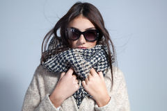 Autumn woman wearing scarf and sunglasses. Studio fashion photo. Autumn woman wearing scarf and sunglasses. toned vintage image Royalty Free Stock Photography