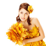 Autumn woman in yellow dress of maple leaves Stock Images