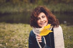Autumn woman with yellow fall leaf in park stock images