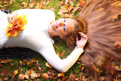 Autumn woman on yellow leafs in hand background Royalty Free Stock Image