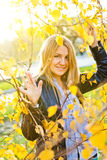 Autumn woman with yellow leaves Stock Images