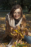 Autumn woman in yellow leaves portrait Royalty Free Stock Photo