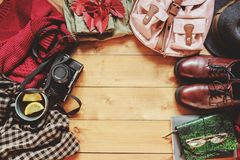 Autumn women fashion clothes set with cozy sweater, shoes, plaid shirt, vintage photo camera, backpack and cup of tea Stock Images