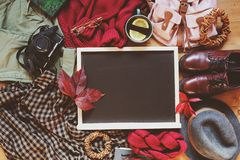 autumn women fashion clothes set with cozy sweater, shoes, shirt, vintage photo camera, backpack and cup of tea Royalty Free Stock Photo