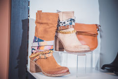 Autumn women's boots lying on the shelf Royalty Free Stock Photos