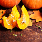 Autumn wood background with pumpkins over wooden table with copy Stock Photos