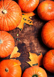Autumn wood background with pumpkins over wooden table with Royalty Free Stock Images